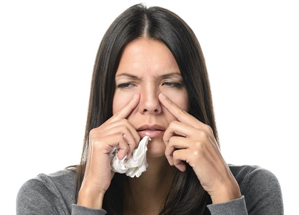 Woman experiencing sinus congestion