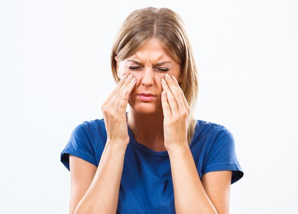 Woman experiencing sinus pain